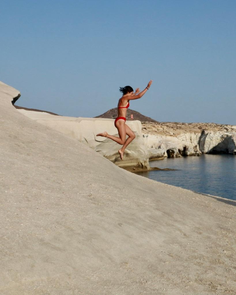 Girl jumps from a ledge in the Sarakiniko waters